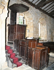 A three decker pulpit in All Saints Church, Great Ayton