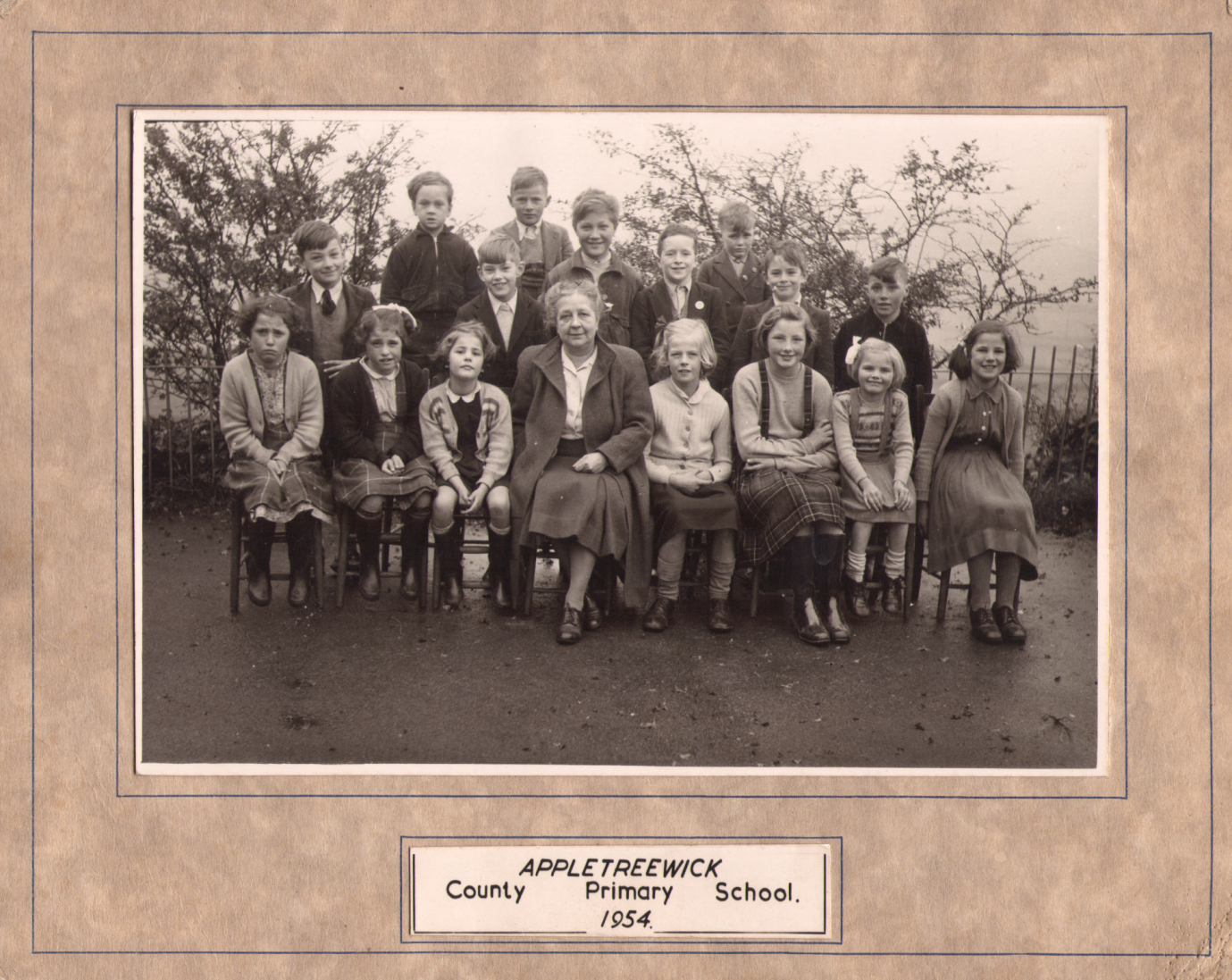 The headteacher and fifteen pupils