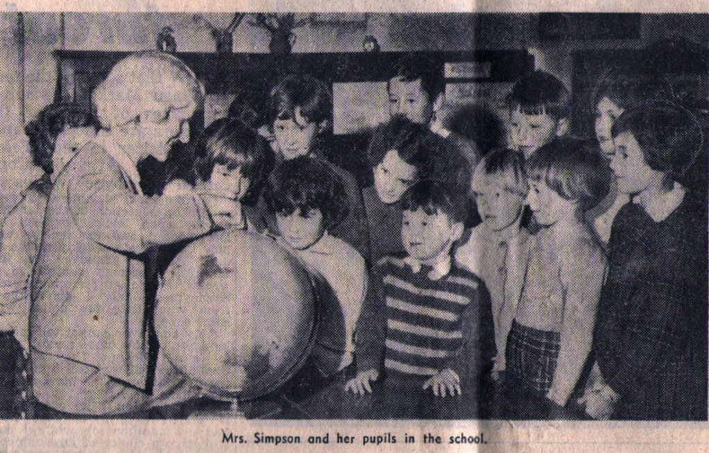 Miss Simpson and her pupils in the school in the early 1960s.